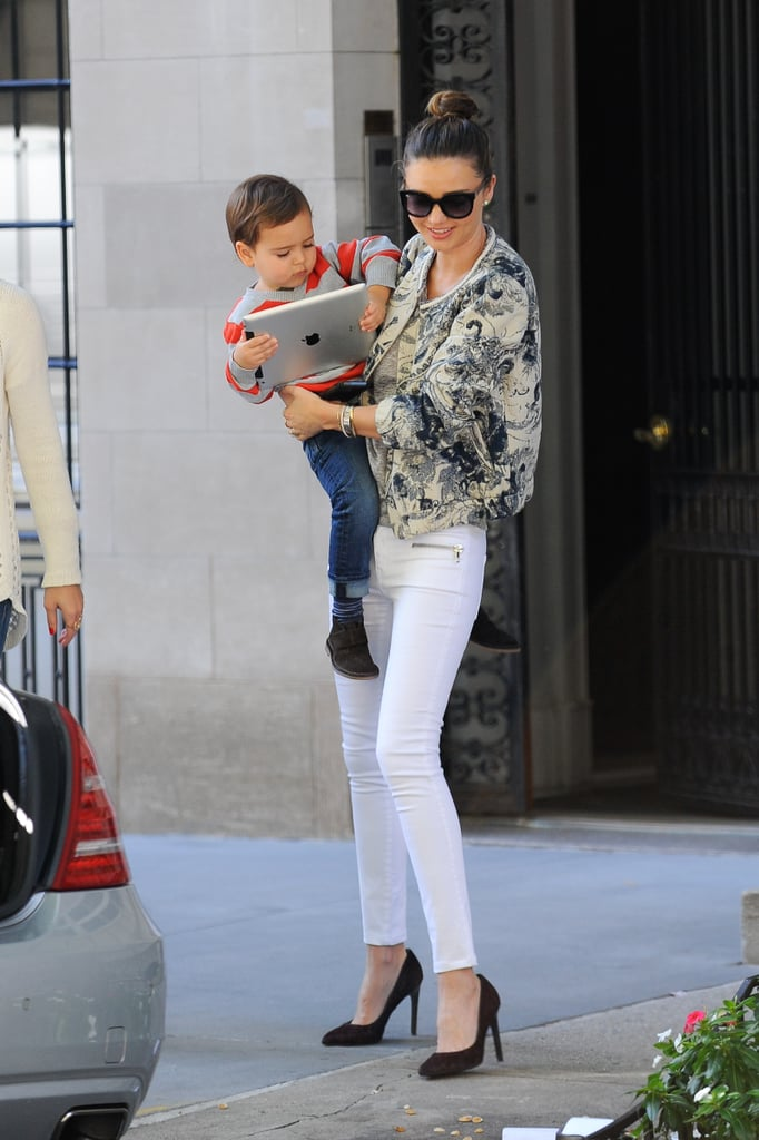"Apple should really consider hiring 2-year-old Flynn Bloom as a spokesperson — after seeing these adorable pics of him playing on an iPad, we almost up and bought one. Flynn and his mum, Miranda Kerr, were all smiles as they left their apartment in NYC yesterday. The duo has been spending lots of sweet quality time together in Manhattan, including daytime outings to the park and the Natural History Museum. Flynn already seems to be cultivating a love of learning, as Miranda shared a photo on Instagram of Flynn reading a book about animals with the caption, ""My little love."" While Miranda and Flynn take to the streets of NYC, Orlando Bloom has been busy heating up the stage with his Broadway debut in Romeo and Juliet. The production opened last week, and Miranda stepped out in two sexy dresses to support her man as he performed with the Juliet to his Romeo, actress Condola Rashad."