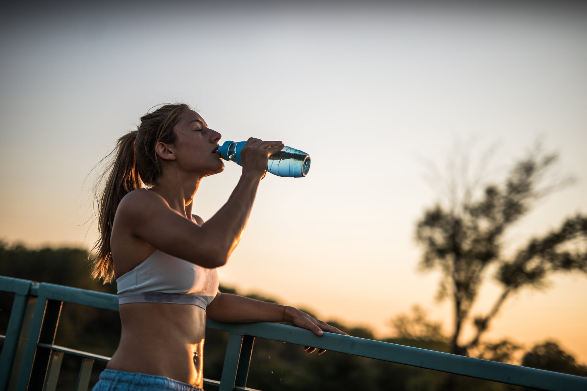 """Hate That """"Sloshy"""" Feeling? Here's How Much Water You Actually Need on a Run, a Doctor Says"""