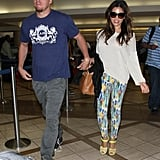 Channing Tatum and Jenna Dewan held hands at the airport.