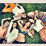 Bar Refaeli lounged in the grass with friends.  Source: Instagram user barrefaeli