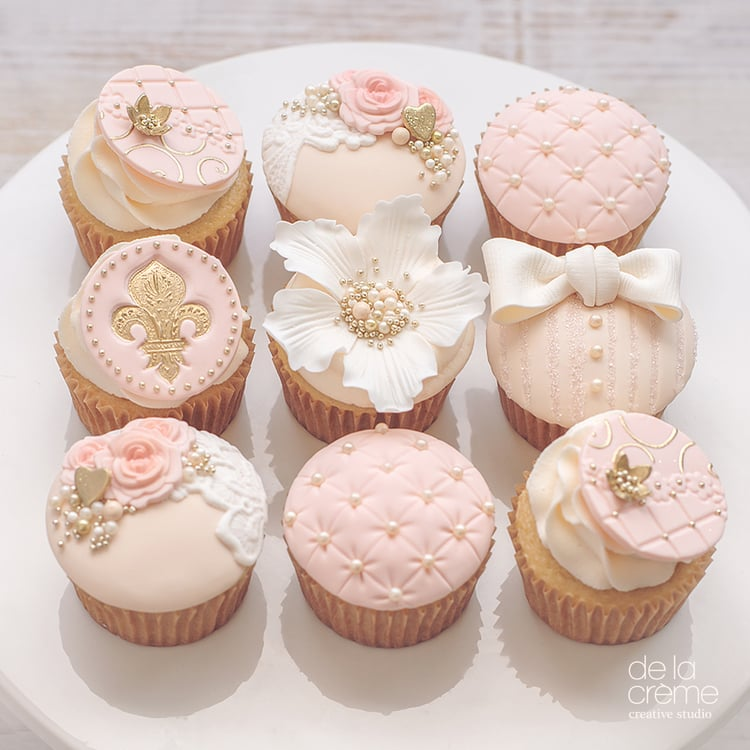 blush pink wedding cake with cupcakes blush and bows cupcakes pretty baby shower cake ideas 12058