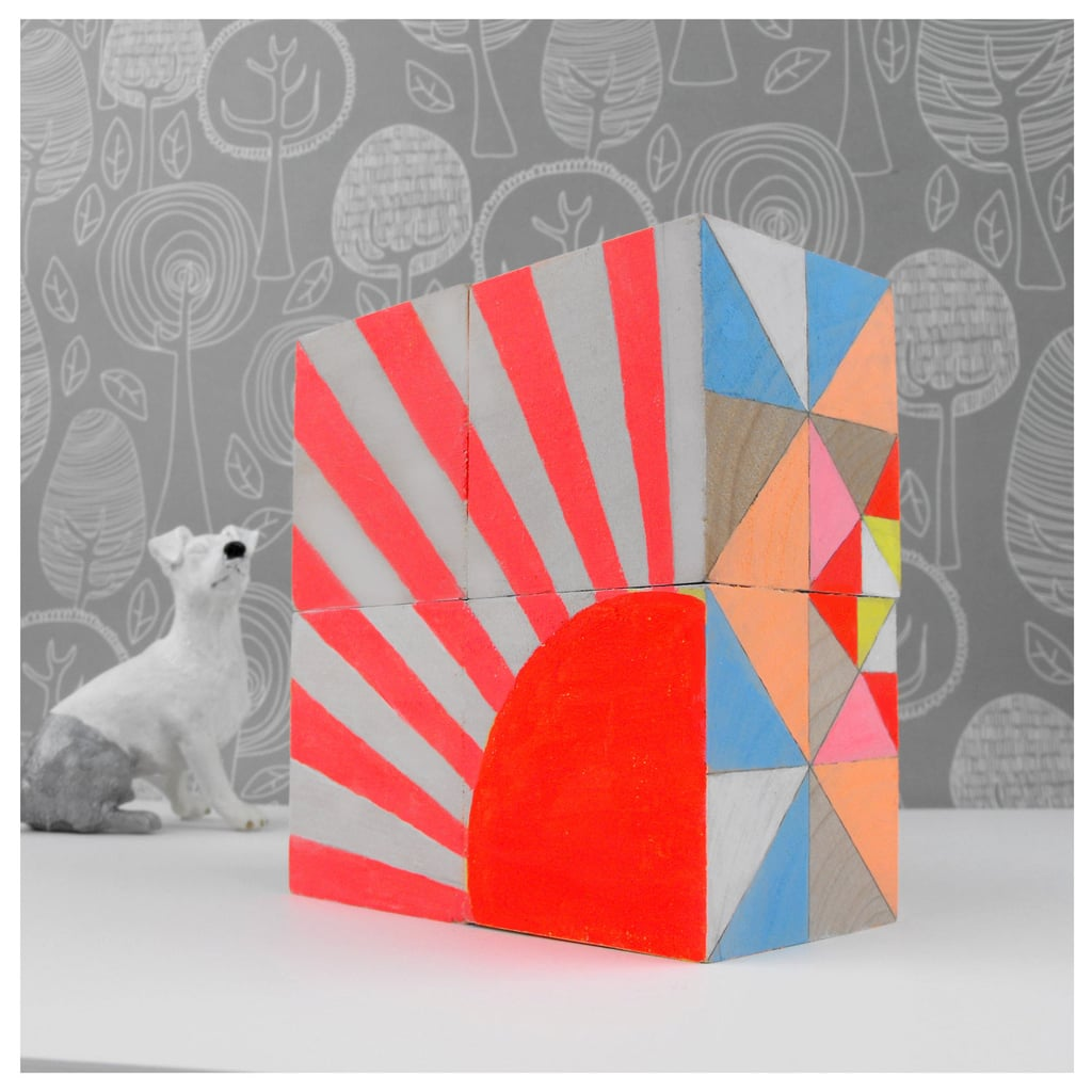 Add these Geometric Neon Art Blocks ($60) to your coffee table for an instant conversation starter.