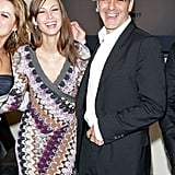 George Clooney and his then-girlfriend Sarah Larson shared a laugh during a December 2007 visit to Rome.