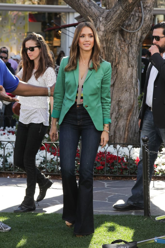 Jessica evoked a '70s-glam vibe in a sophisticated Lisa Ho blazer, striped Tibi blouse, and flared high-waist denim in LA.