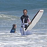 David Beckham wore a long-sleeve rash guard to keep warm.