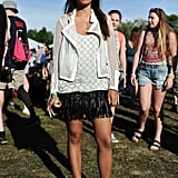 This festivalgoer embraced the season's fringe trend with a black miniskirt that she paired with a mesh jacket, Zimmermann top, and Kenzo shoes.