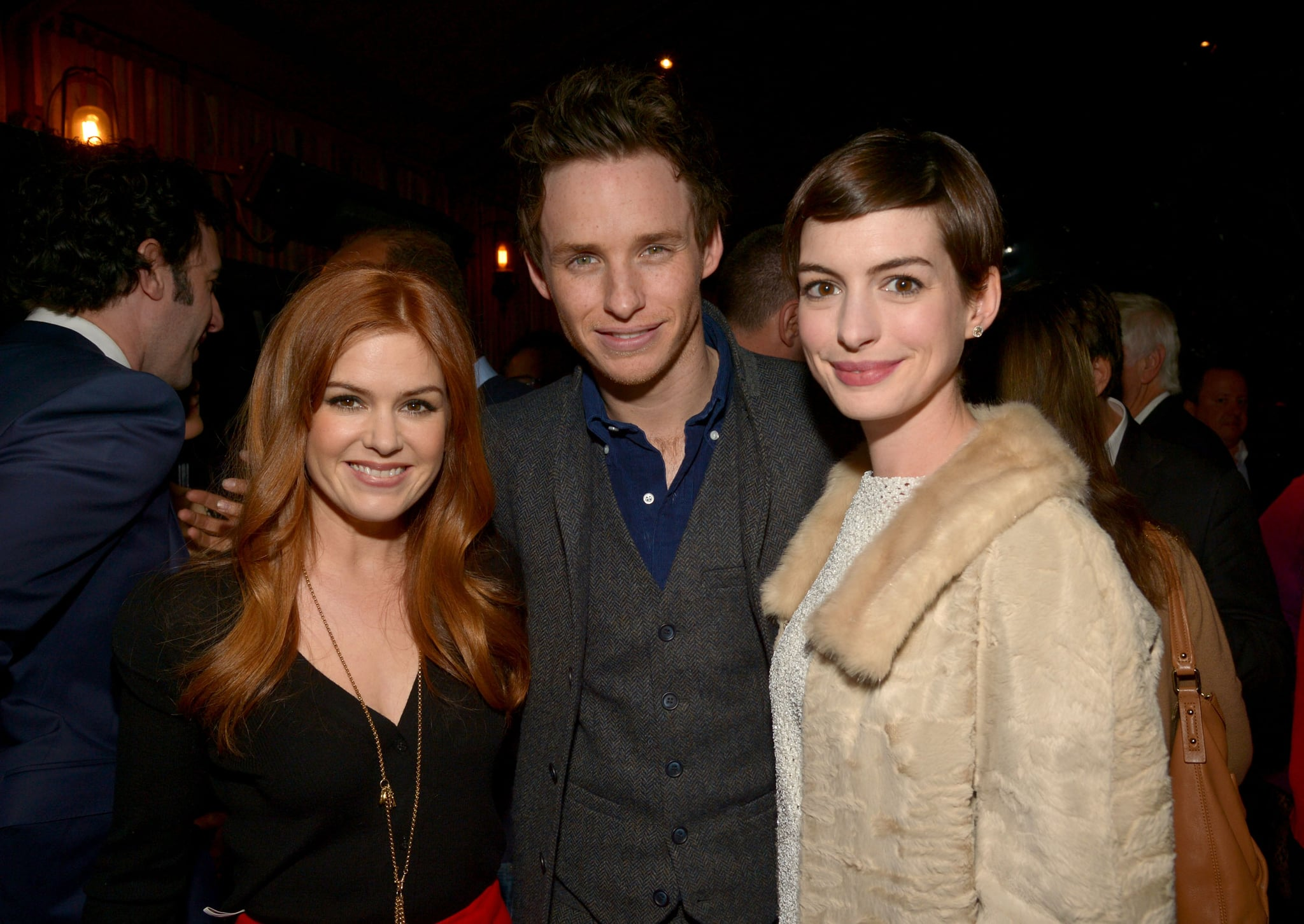 Anne Hathaway, Isla Fisher, and Eddie Redmayne hung out at a Les Misérables pre-Oscars party in LA on Wednesday.