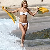 Erin Heatherton walked through the waves.
