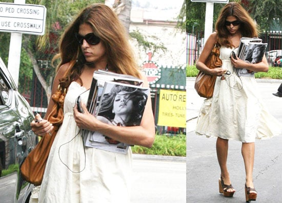 Eva Mendes Keeps Her Obsession in Her Arms