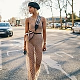 Dare to wear a sheer crochet dress with a bodysuit.