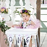 Getting ready to eat your first birthday cake doesn't get much more stylish than this! The O-N-E banner from The Lovely Ave was a great item to throw on the birthday girl's high chair! Time to dig in!
