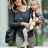 Sarah Jessica Parker carried Tabitha Broderick, who had a stuffed animal in her hand.