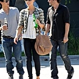 We love how balanced her sheer floral blouse and cropped tweed Louis Vuitton topper with chunky Chanel mules and a earthy Givenchy satchel in September 2010.