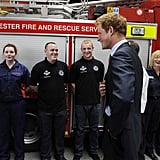 Prince Harry meets with firefighters.