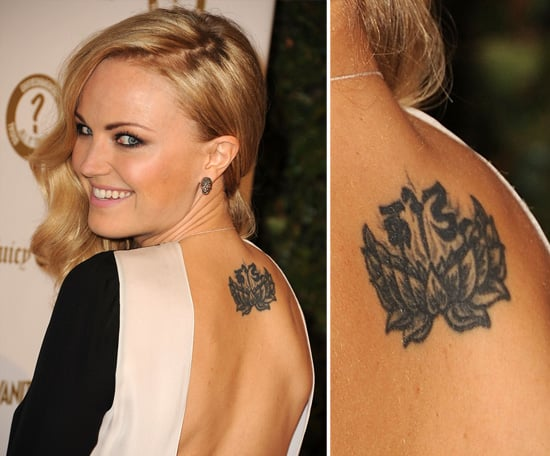 "Malin Akerman, raised Buddhist, has a large lotus flower and a Tibetan Sanskrit message which reads ""to play"" inked on the upper part of her back."