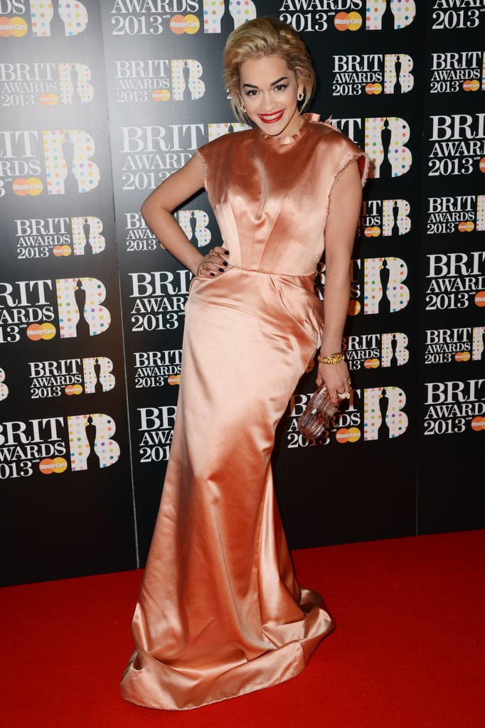 Rita Ora glowed in a silky peach gown and plenty of sparkly baubles at the 2013 Brit Awards.