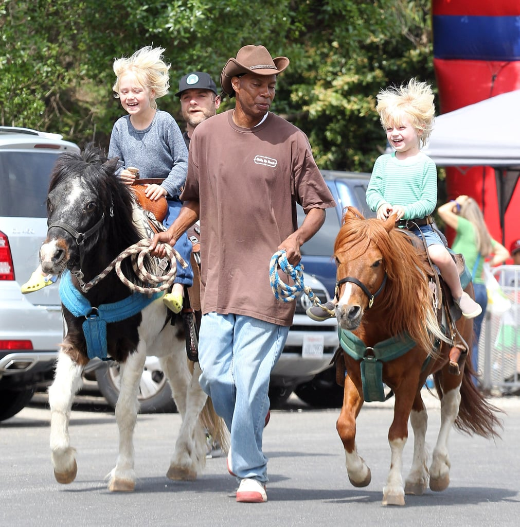 Liev Schreiber watched as his sons, Sasha and Kai, took a precious pony ride through an LA farmers market on Sunday.