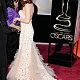 Kristen Stewart showed off the train on her Reem Acra gown at the Oscars.