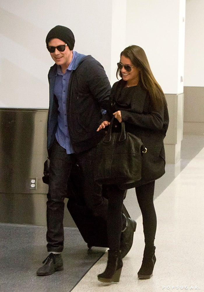 Lea Michele and Cory Monteith smiled as they arrived at LAX.