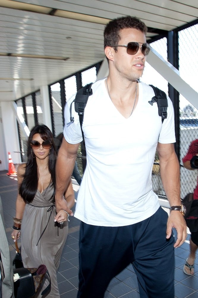 Kim Kardashian and Kris Humprhies reportedly caught a flight headed to Europe for their minimoon.