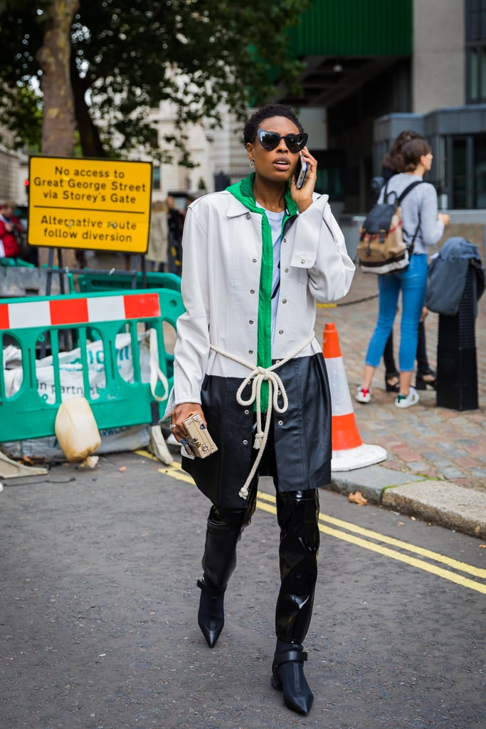 Play up the PVC appeal with a rain jacket layered over your pants.