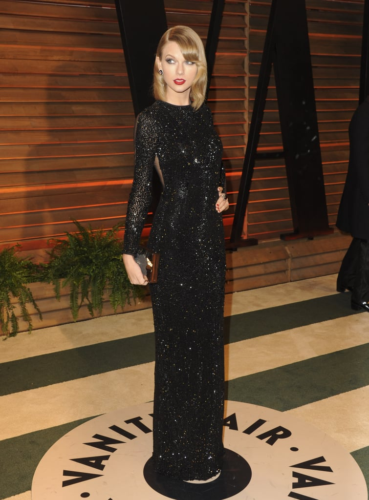 Taylor Swift wore bright red lipstick and a long black dress ...