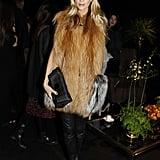 Poppy Delevigne showed off one of our favourite combos — a furry topper and leather pants — at Louis Vuitton.