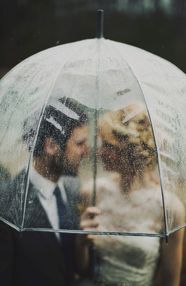This rainy-day wedding featured a romantic umbrella shot.