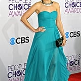 Rachael Leigh Cook chose a diaphanous teal-hued Oliver Tolentino sweetheart gown, only accenting the look with a silver collar necklace and silver heels.