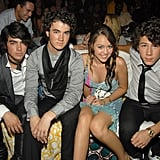 The Jonas Brothers With Miley Cyrus at the Teen Choice Awards in 2007