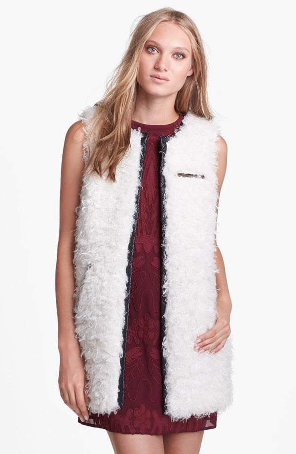 What better way to counter a soft feminine top or dress than with this fuzzy