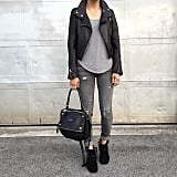 Nothing makes gray-on-gray look edgier than a leather jacket and black booties.