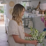 Margot delicately arranging flowers is what I'd like to imagine myself doing on any given weekend instead of watching old seasons of America's Next Top Model or what have you. I also love that crisp white Smeg Electric Kettle.