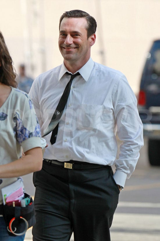 Jon Hamm smiles on the set of Mad Men.