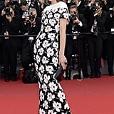 Milla Jovovich arrived to the premiere of Blood Ties in a floor-length black, white, and red floral Chanel gown that never stopped shimmering, thanks to elaborate sequinned embellishment.