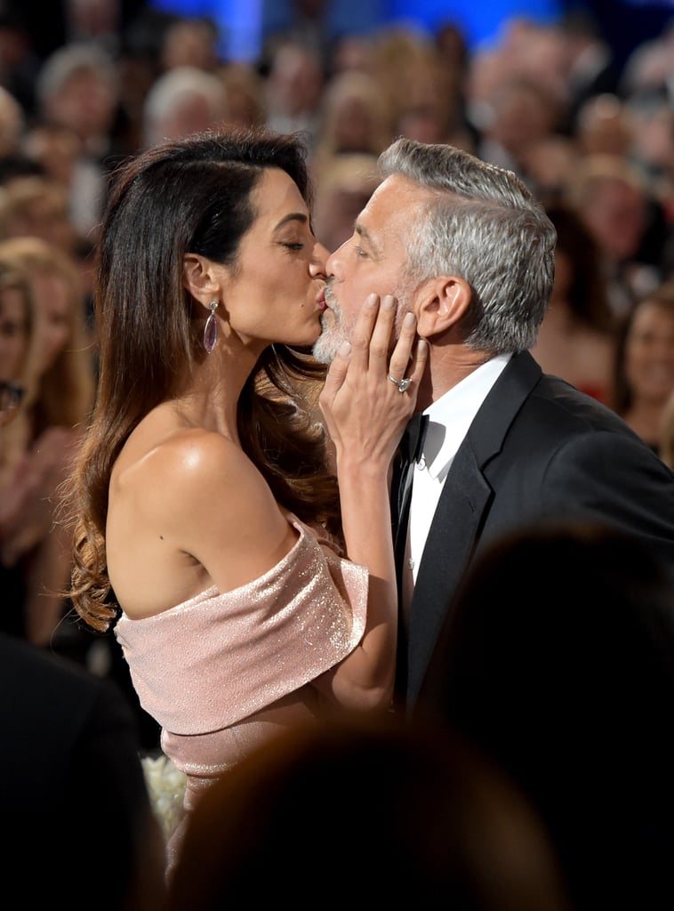 George Clooney said goodbye to the single life when he went public with his romance with Amal Alamuddin during an African safari in March 2014. The two had a whirlwind courtship before they made things official when they tied the knot in Venice, Italy that September after a weekend full of festivities. In their years together, they've shared plenty of sweet moments at events, on red carpets, and while fighting for causes they believe in. And in June 2017, the couple welcomed twins, Ella and Alexander. Long story short: they're kinda perfect.      Related:                                                                                                           George and Amal Clooney Steal a Few Kisses on the Set of His New Movie