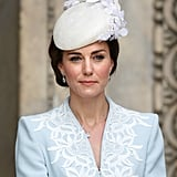 Kate's celebratory ensemble for the queen's 90th birthday festivities included a whimsical Jane Taylor hat atop her custom Catherine Walker coat.