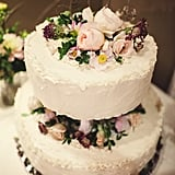 Peonies, roses, and a scattering of wild flowers give this cake a vintage look.