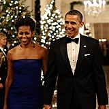 Barack and Michelle Obama arrived in the East Room of the White House to attended a reception for Kennedy Center Honorees in December.