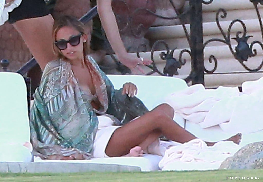 Nicole Richie relaxed by the pool.