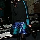 Liv Tyler made a serious case for turtleneck sweaters, working her black top with a cool-hued skirt and turquoise shoulder bag at Proenza Schouler.