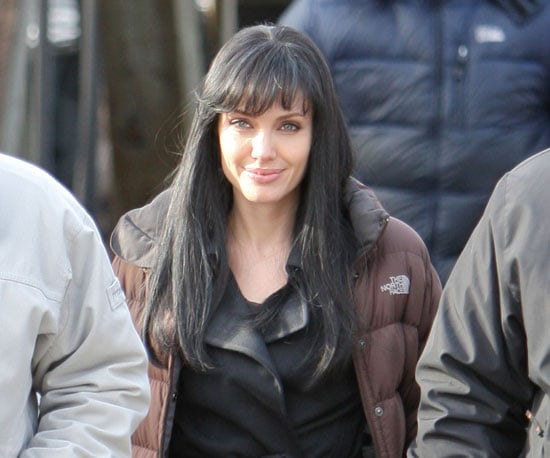Slide Photo of Angelina Jolie Wearing a Brown Coat on the Set of Salt