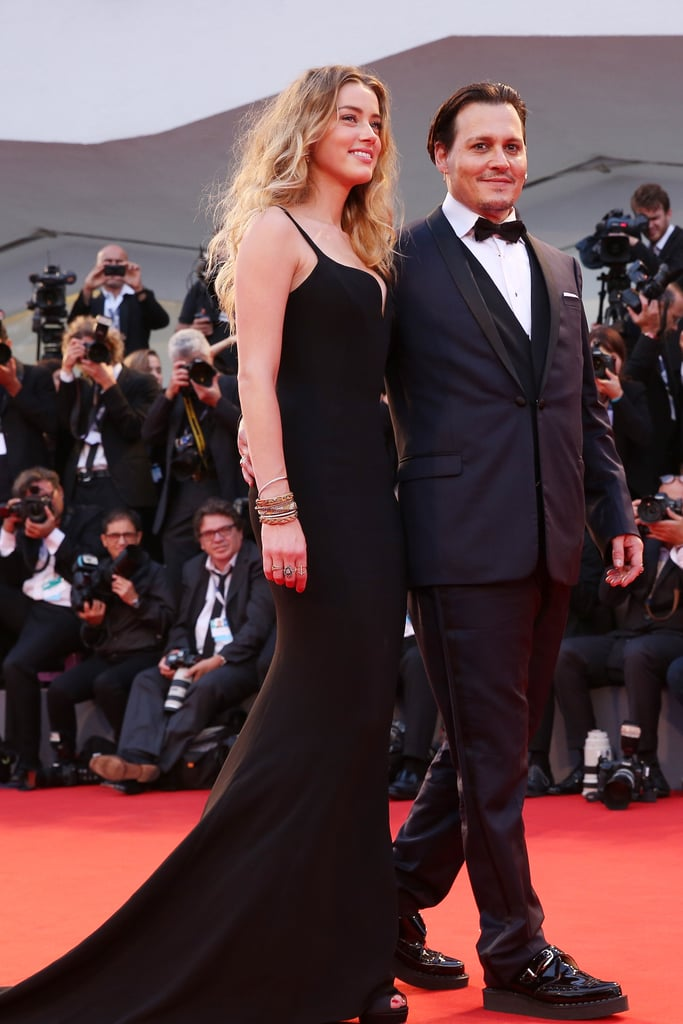 """Johnny Depp had his arm around Amber Heard when the couple walked the red carpet for the Black Mass premiere at the Venice Film Festival on Friday. Amber stunned in a black gown, all smiles as she gave Johnny a sweet glance in front of the cameras. The couple tied the knot on his private island in the Bahamas earlier this year, and in Elle's July issue, Amber shared what it's like to be married to Johnny, saying, """"I fall in love again and again. Nothing is a dramatic change. We've been together for a long time now, so it's been a fairly organic process. I have a fiercely independent spirit."""" Keep reading for a look at gorgeous pictures of the couple's appearance in Italy, then check out all the stars at the Venice Film Festival."""