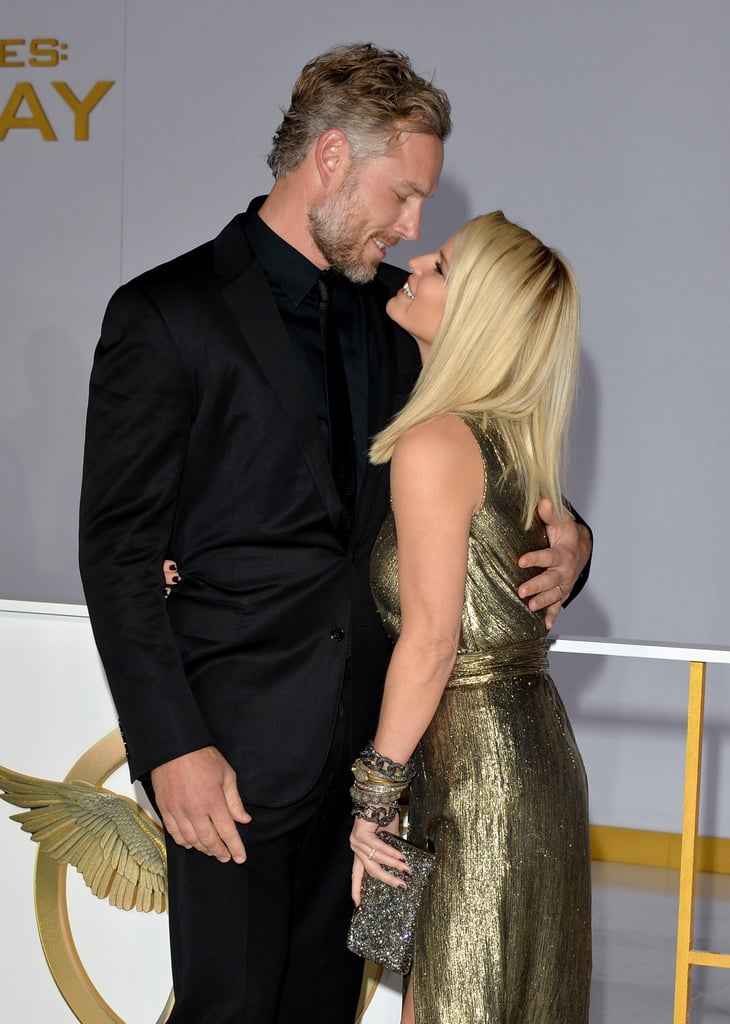 Jessica Simpson and Eric Johnson showed plenty of PDA when they arrived at the LA premiere of The Hunger Games: Mockingjay — Part 1 on Monday. While Jennifer Lawrence and her costars were the stars of the night, all eyes were on Jessica and Eric when they shared adorable red carpet kisses while walking into the event. The pair met up with Jessica's sister, Ashlee Simpson, and her new husband, Evan Ross, to celebrate the new movie at the official afterparty. (Evan plays Messalla in the Mockingjay films.) Keep reading to see all of Jessica and Eric's hot pictures from the premiere, and be sure to check out more adorable photos from their family.