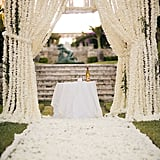 Outdoor weddings offer all sorts of possibilities for ceremony decor — especially when it comes to creative, unexpected altar alternatives. Whether you're into ornate, romantic archways or delicate DIY details, POPSUGAR Home is providing some of the most original backdrop ideas from across the web. Photo by James Christianson via Style Me Pretty