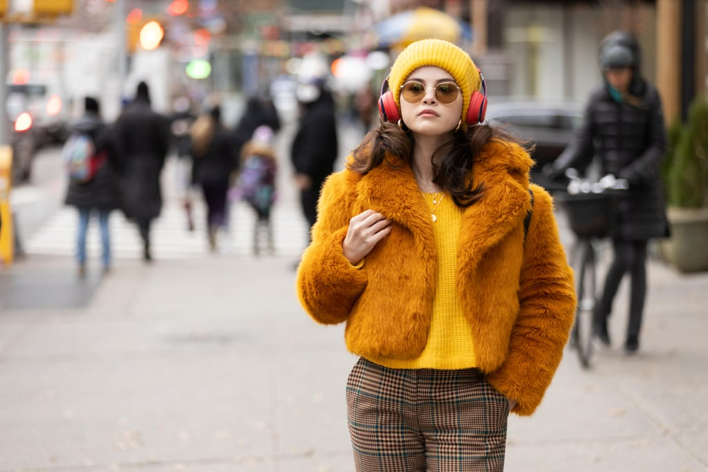 """POPSUGAR: Where did you find the inspiration for Mabel's wardrobe—it's obviously very current, but also not totally tied up in trends or too trend forward — how would you describe her style? Dana Covarrubias: Similar to how some animals use bright colors as a warning signal or hard exoskeletons to protect themselves from predators- Mabel is using her teddy coats, bright faux furs, and combat boots as protective armor and a warning saying: """"Don't mess with me"""". As the season progresses she begins to drop her guard and her costumes soften and simplify. Mabel at her core is an artist, a painter, and a knitter. I wanted to balance her tough exterior with her more artistic side. We incorporated some soft, loose knits into her costumes, cozy paint-splattered coveralls, and drapey bohemian kimonos, but she would still pair these with a heavy, treaded boot (again a kind of armor). Like Selena and her character Mabel, I am also half-Mexican and I wanted to somehow represent that heritage in Mabel's costumes. I decided to use the Marigold as the core inspiration from which to draw this cultural connection. Marigolds play a significant role in Mexican culture and iconography- representing grief and resurrection as well as passion and creativity- which was perfect for Mabel. She's haunted by her past, held back by her grief, and hoping to resurrect into something new. Selena also looks amazing in the color marigold! A lot of her color palette came from that inspiration. I had a wide range of other references: from the classic noir mystery Double Indemnity, to Hitchcock's Rear Window, to the cover art from mystery book series The Hardy Boys, Sherlock Holmes and Nancy Drew. I also referenced cult comedy films like Clue, The Big Lebowskik, Who Framed Roger Rabbit, So I Married An Axe Murderer, and Fargo."""