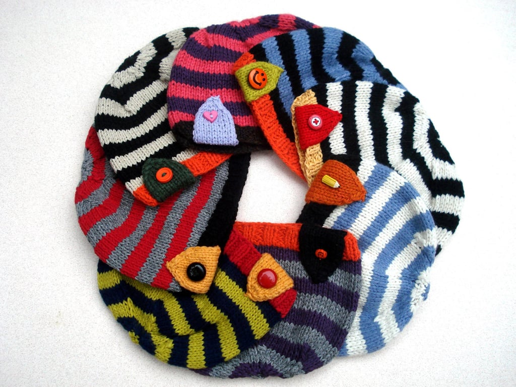These bright knit hats ($27) can easily be kept in their backpacks during the Winter.