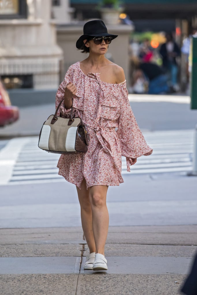 Katie Holmes wore a flirty Spring dress that will take her well into the Summer. The 39-year-old actress stepped out in New York City on May 14 wearing Zimmerman's Radiate Skater Shirt Dress, which features billowing sleeves and a loose off-the-shoulder neckline. Katie accessorized the look with crisp white sneakers, a classic Tod's handbag, oversize sunglasses, and a wide-brim hat. The finished result is an easy, breezy ensemble that we'd certainly keep coming back to in the warmer months, if only because it's so damn simple to slip on. Ahead, shop Katie's exact dress, as well was similar printed options.      Related:                                                                                                           Wow, Wow, Wow — These 60 Cute Dresses Are a Summertime Dream