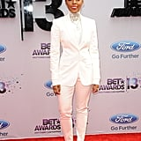 Janelle topped off her all-white suited style with an opulent choker necklace and shimmering silver heels.