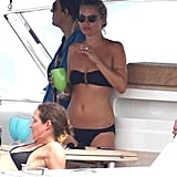 Kate Moss wore a black bikini with a bandeau top on a boat.